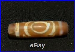 Ancient dzi beads with double eyes