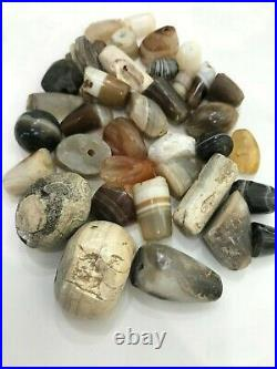 Dzi Old Beads A beautiful collection of broken ancient banded agate beads